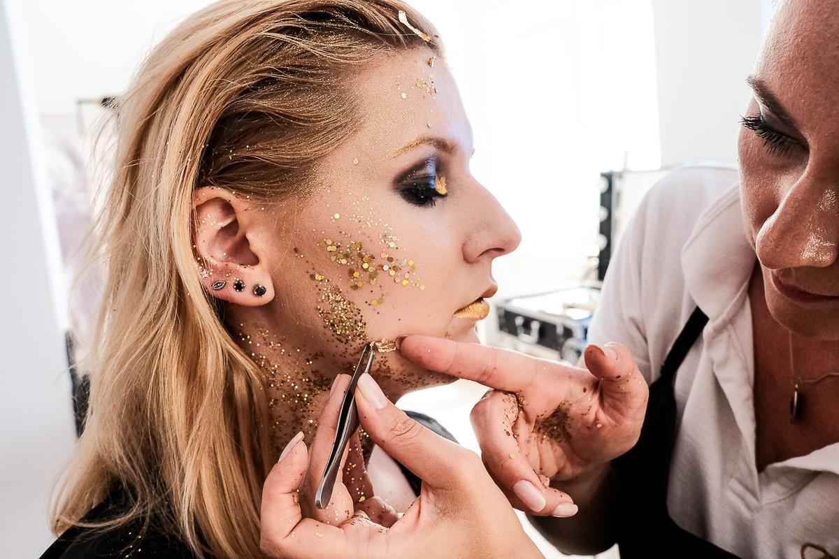 make up artist creating glitery look