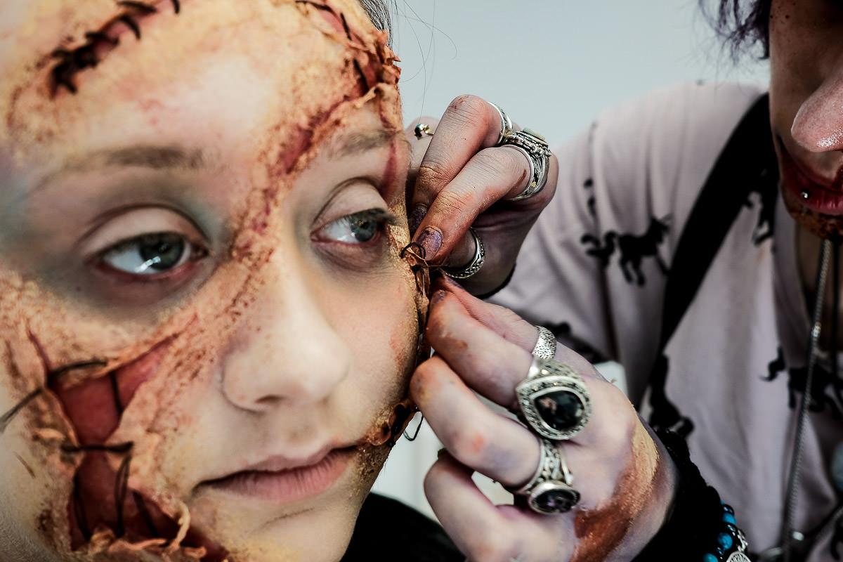 make up artist creating halloween make up