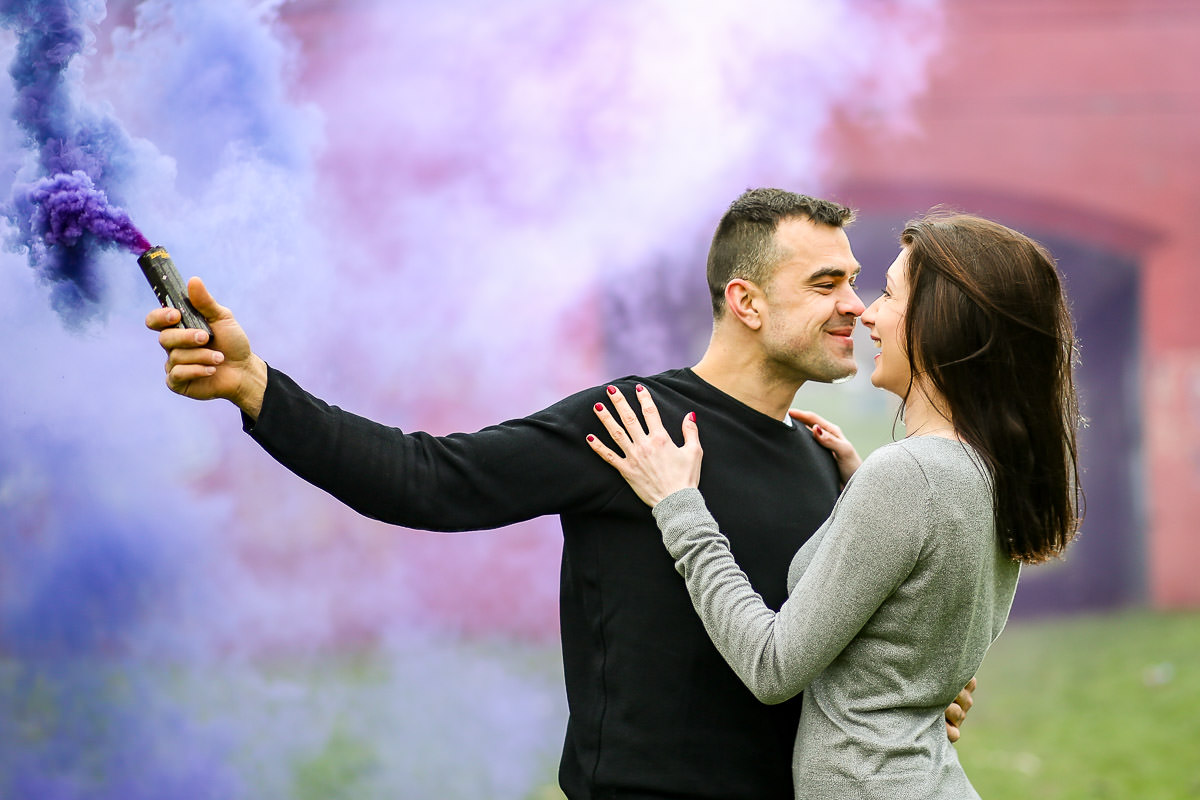Smoke bomb hold by couple at the engagement shoot in Surrey
