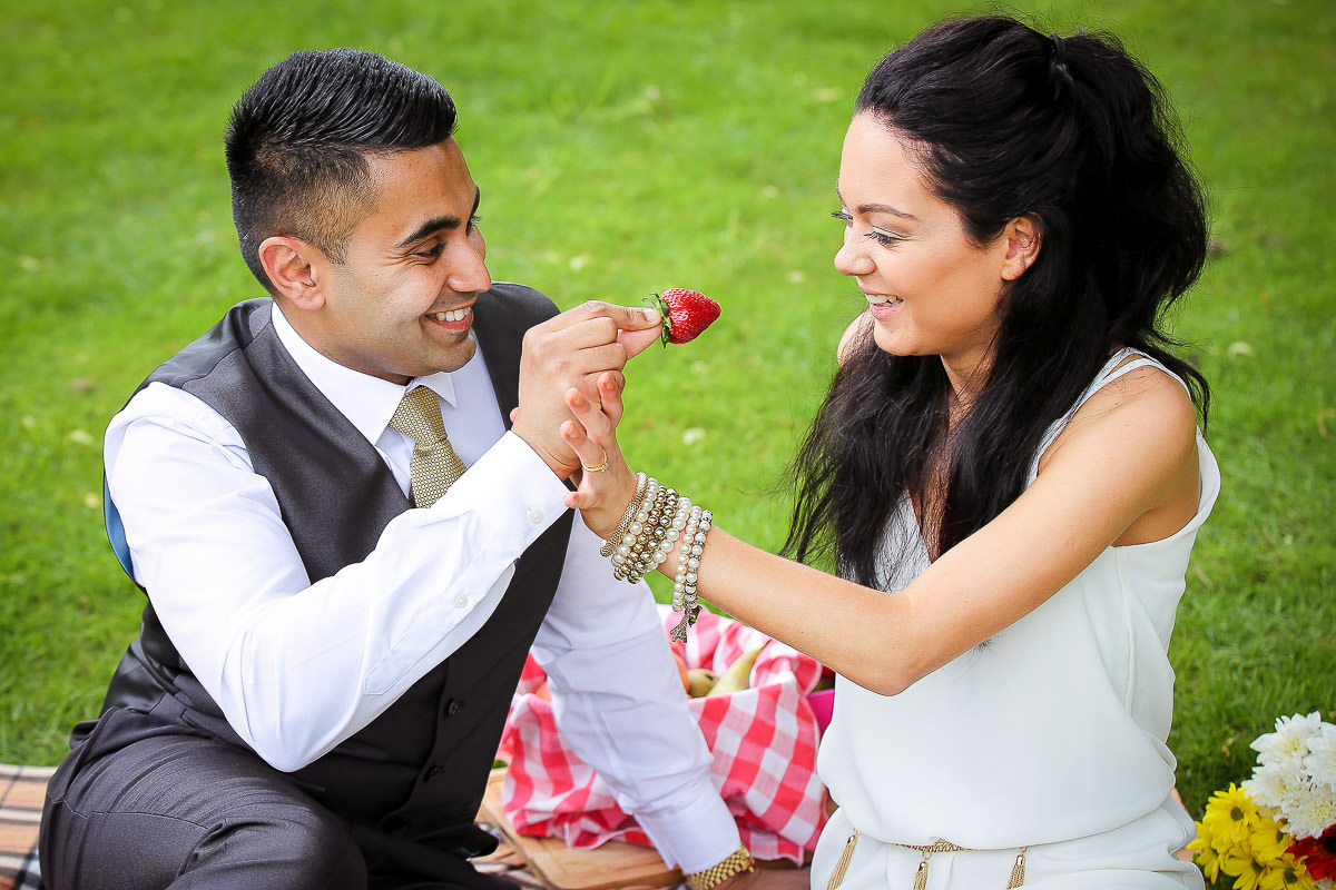 Couple having picnic at the Wrest Park Engagement Shoot