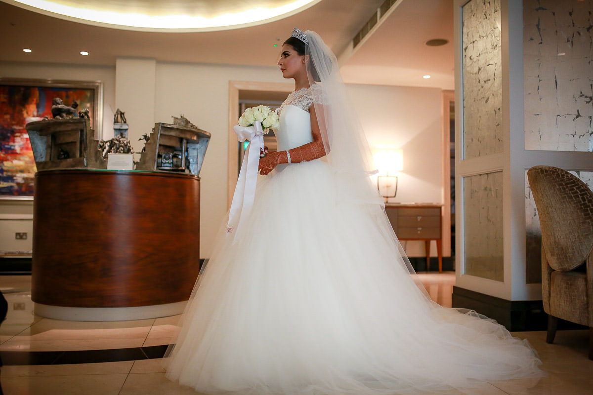 bride crossing conrad hotel london lobby