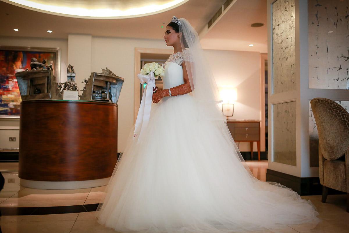 bride crossing conrad hotel london lobby