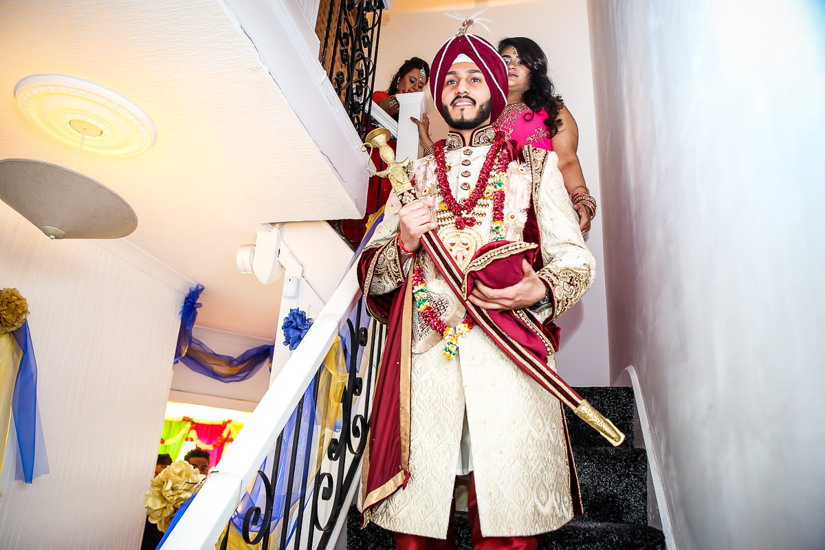 sikh groom leaving his family house