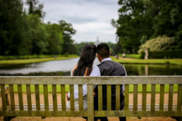 couple sitting at the bench in wrest park by buckingamshire wedding photographer