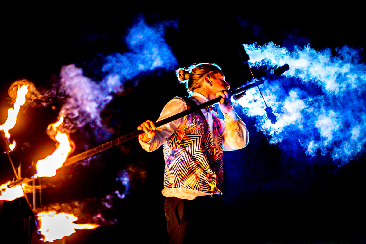 stilt walker fire juggler