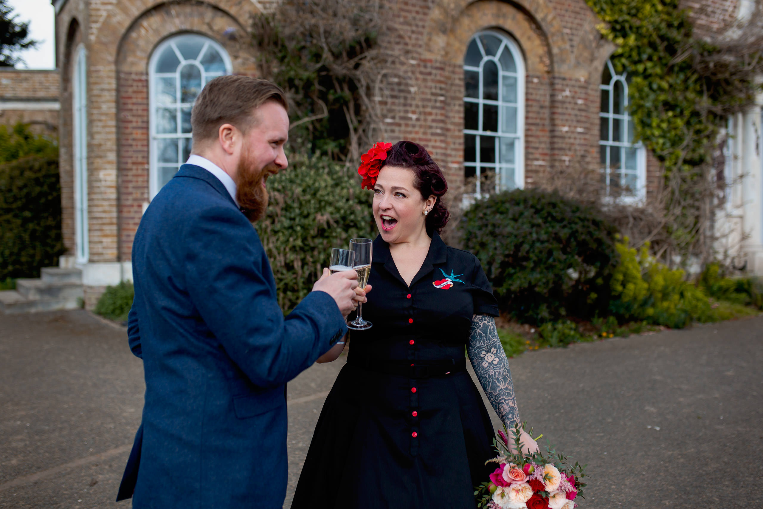 couple celebrating with champagne covid19 micro wedding at morden hall registry office